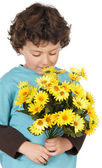 Adorable child with flowers — Stock Photo