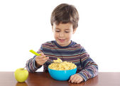 Child breakfasting — Stock Photo