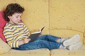 Adorable boy reading — Stock Photo