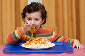 Child eating in his house — Stock Photo