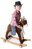 Adorable boy playing cowboys with a wood horse — Stock Photo