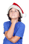 Pensive child with Santa hat — Stock Photo