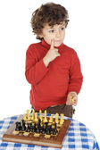 Adorable boy playing the chess — Stock Photo
