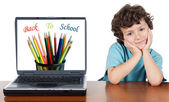 Child whit laptop — Stock Photo