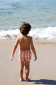 Boy playing in the beach — Stock Photo