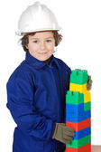 Adorable future builder constructing a brick wall with toy piece — Stock Photo
