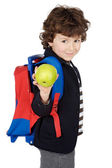 Adorable boy student with knapsack and apple — Stock Photo
