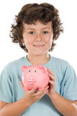 Adorable boy with pink piggy bank — Stock Photo