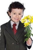 Adorable boy with flowers — Stock Photo