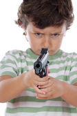 Boy with one pistol on his hands — Stock Photo