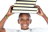 Child with books in the head — Stockfoto
