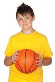 Beautiful child with basket ball — Stock Photo