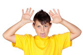 Funny child with yellow t-shirt mocking — Stock Photo