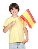 Freckled boy with spanish flag — Stock Photo