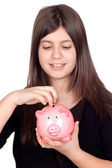Adorable preteen girl with money box — Stock fotografie