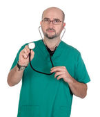 Doctor listening with a stethoscope — Stock Photo