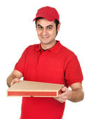 Boy with red uniform delivering a pizza box — Stock Photo