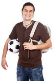 Young with soccer ball and backpack — Stock Photo