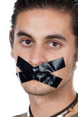 Man with masking tape on mouth — Stock Photo