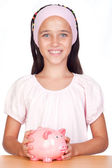 Little girl with with piggy-bank — Foto de Stock