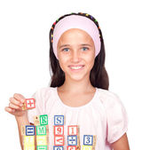 Little girl with with wooden blocks stacked — Stock Photo