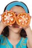 Girl with tomatoes in her eyes — Stock Photo