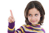 Beautiful girl pointing with focus in the finger and face out of — Stock Photo