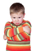 Angry child with crossed arm — Stock Photo