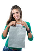 Pretty girl with silvered bag shopping — Stockfoto