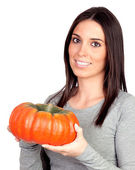 Beautiful girl with a big pumpkin — Stock Photo