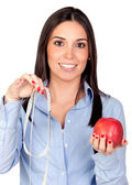 Beautiful girl with a red apple and tape-measure — Stock Photo