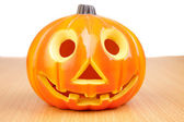 Smiling pumpkin on wooden surface — Stock Photo