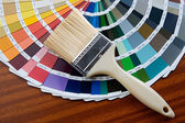 Paintbrush with card of colors — Stok fotoğraf