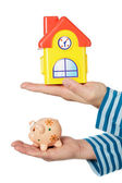 House and moneybox in hands — Stock Photo