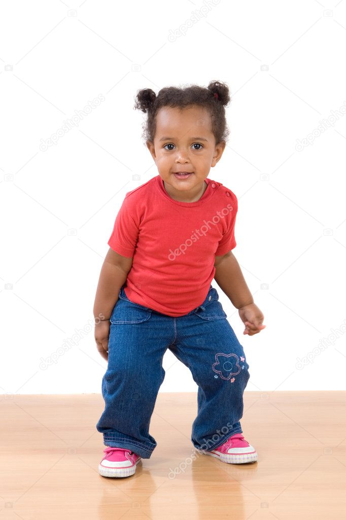 Adorable african baby dancing over wooden floor  Stock Photo #9430729