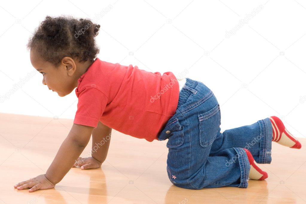 Adorable african baby crawl over wooden floor — Stock Photo #9430743