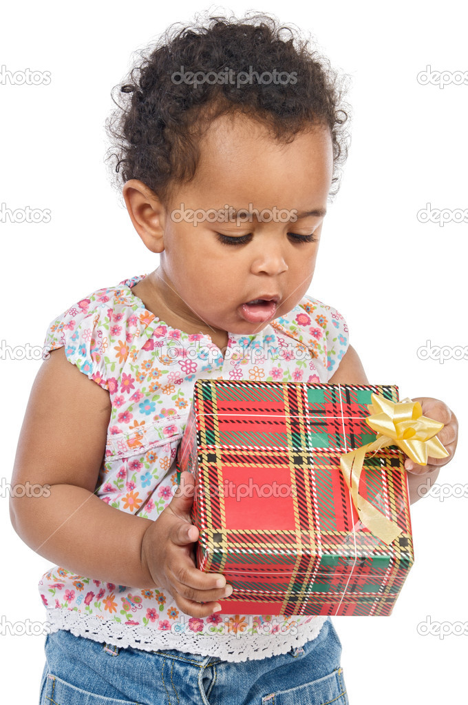 Baby with a gift box a ver white background — Stock Photo #9431321
