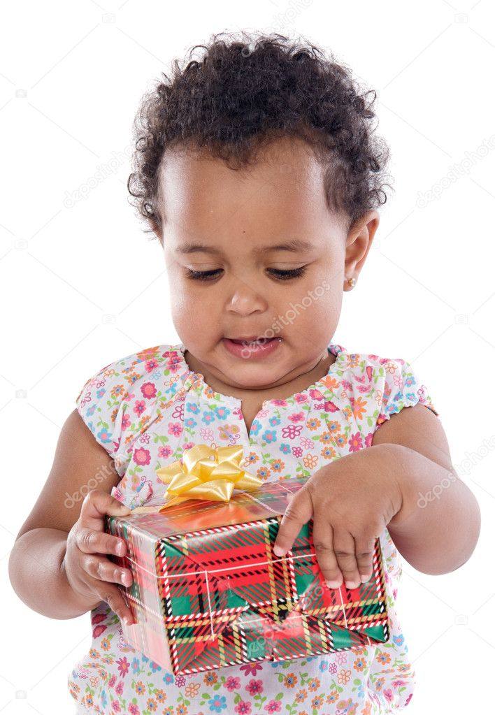 Baby with a gift box a ver white background  Stock Photo #9431347