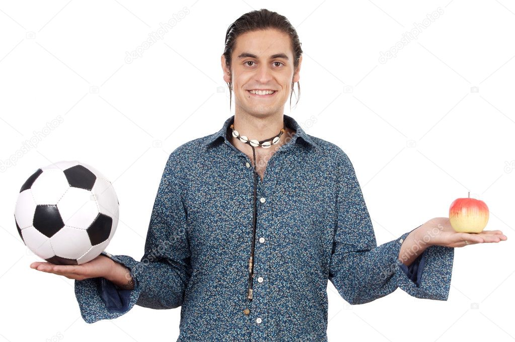 Attractive young holding soccer ball and apple  Stock Photo #9435730