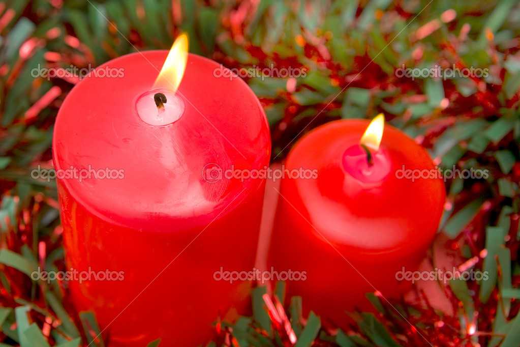 Red candles of Christmas lit with red and green ribbon — Stock Photo #9438159