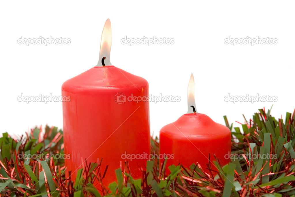 Red candles of Christmas lit on a over white background — Stock Photo #9438160