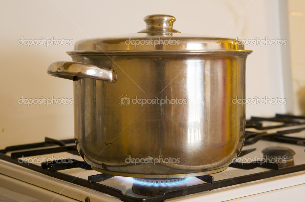 Photo of a pot on the flames of kitchen oven burning gas  Stock Photo #9438787