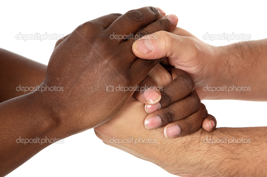 Handshake between races a over white background  Stock Photo #9439737