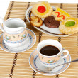 Stock Photo: Cup of coffee with cakes