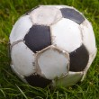 Old football ball - Stock Photo