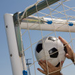 Soccer ball in the goal net — 图库照片