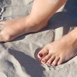 Feet in the sand — Stock Photo #9440404