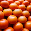 Piling up of tomatoes - Stock Photo