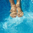 Feet refreshing in swimming pool — Stock Photo