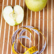 Apple with tape to measure — Stock Photo
